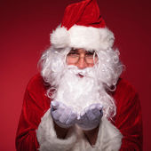 Santa claus is holding something on his hands — Foto de Stock