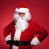 Santa claus is standing with his hands on hips — Stock Photo