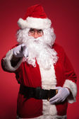Santa claus is pointing his finger — Stock Photo
