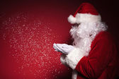 Side view of santa claus blowing snow — Stock Photo