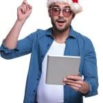 Santa man reading on tablet pad is having a idea — Stock Photo