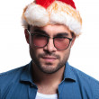 Serious young casual man in santa hat — Stock Photo