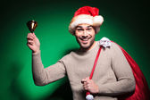 Happy santa man ringing his little bell — Stock Photo