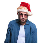 Undecided young man in santa hat — Stock Photo