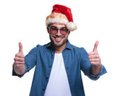 Young man in santa hat making the ok sign — Stock Photo