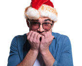 Anxious young man in santa hat — Stock Photo