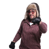 Man in warms winter clothes is driving and imaginary car — Stock Photo