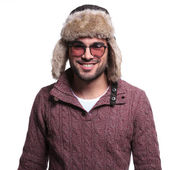 Smiling casual man in winter clothes and furry hat — Stock Photo