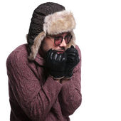 Side of a young man worrying about cold weather — Stock Photo