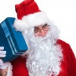 Santa claus si listening to a gift box — ストック写真