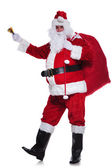 Santa claus is wishing you merry christmas — Stock Photo