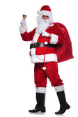 Full body picture of santa claus sounding his bell — Stock Photo