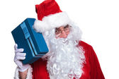 Santa claus si listening to a gift box — Foto Stock