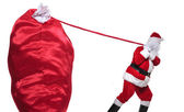 Santa claus is pulling a huge bag of presents — Stock Photo