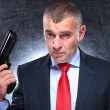 Dramatic picture of old assassin holding his gun — Stock Photo #38601361