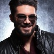 Young man with long beard and sunglasses smiling — Stock Photo