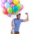 Happy casual man winning a big bunch of balloons — Stok fotoğraf