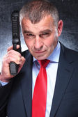Old killer in suit and tie smiling — Stock Photo