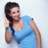 Casual woman making the ok thumbs up hand sign — Stock Photo