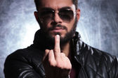 Man with long beard and sunglasses giving you the finger — Stock Photo
