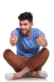 Seated casual man making the ok sign — Stock Photo