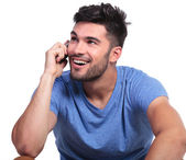Casual man talking on phone and looks up — Stock Photo