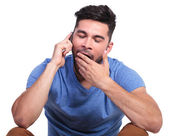 Man is being bored by the phone conversation — Stock Photo