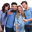 Smiling man taking a photo of his friends with phone — Stock Photo #39037191