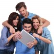 Casual group of friends reading bad news on tablet — Stock Photo #39037253