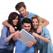 Casual group of friends reading bad news on tablet — Stock Photo