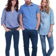Three young casual people standing — Stock Photo