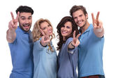 Happy group of young people making the victory hand sign — Stock Photo