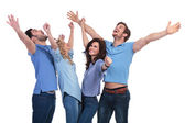 Casual people celebrating success and looking up — Stockfoto