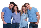 Embraced group of casual friends smiling — Stock Photo