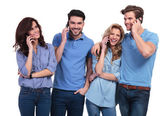 Happy group of casual people talking on their phones — Stock Photo