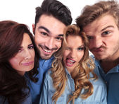Funny wide angle picture of casual people making faces — Stock Photo