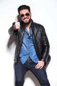 Man in leather jacket and sunglasses making the ok sign — Stock Photo