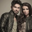 Stock Photo: Embraced modern couple in leather jackets smiling