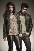 Fashion man and woman in leather clothes — Stock Photo
