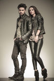 Fashion couple in casual leather jackets posing — Stock Photo