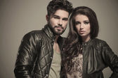 Embraced modern couple in leather jackets smiling — Stock Photo