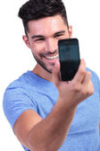 Man taking his own picture with his smart phone — Stock Photo