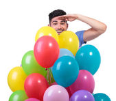 Man is looking far from behind a baloons bunch — Stock Photo