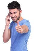 Casual man with good news on the phone — Stock Photo