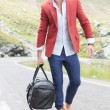 Stock Photo: Young mwalks with bag on road