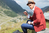 Young fashion man with cigarette outdoor — Stock Photo