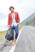 Young man on the side of the road — Stock Photo