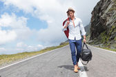 Young fashion man comes down the road — Stock Photo