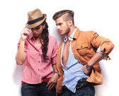 Young casual man looking at his girlfriend — Stock Photo