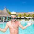 Smiling young man  welcoming you to the pool — Stock Photo #41898869